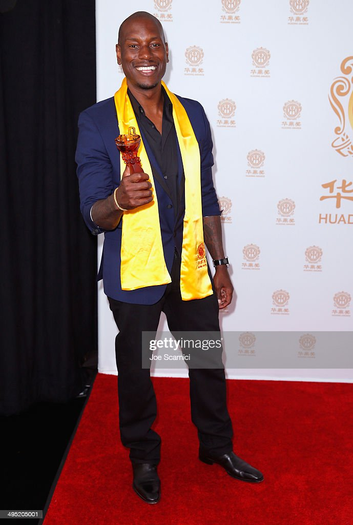 Actor <a gi-track='captionPersonalityLinkClicked' href=/galleries/search?phrase=Tyrese&family=editorial&specificpeople=206177 ng-click='$event.stopPropagation()'>Tyrese</a> Gibson poses with the Best Global Movie of the Year award for 'Fast & Furious 6' in the press room during the Huading Film Awards on June 1, 2014 at Ricardo Montalban Theatre in Los Angeles, California. Huading Film Awards is China's #1 Film awards, in the U.S. for the first time.
