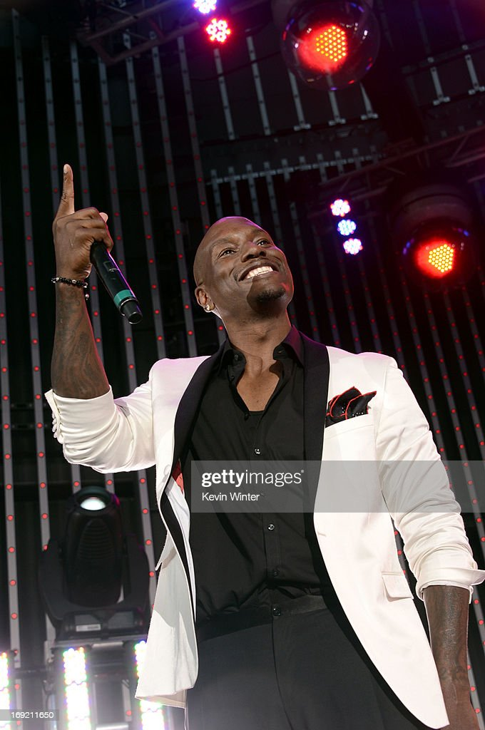Actor <a gi-track='captionPersonalityLinkClicked' href=/galleries/search?phrase=Tyrese&family=editorial&specificpeople=206177 ng-click='$event.stopPropagation()'>Tyrese</a> Gibson speaks onstage at the premiere of Universal Pictures' 'Fast & Furious 6' at Gibson Amphitheatre on May 21, 2013 in Universal City, California.