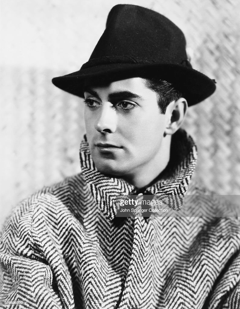 Actor <a gi-track='captionPersonalityLinkClicked' href=/galleries/search?phrase=Tyrone+Power&family=editorial&specificpeople=94168 ng-click='$event.stopPropagation()'>Tyrone Power</a> in Overcoat and Hat