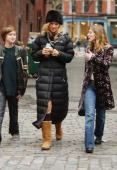 Actor Uma Thurman talks with other cast members on the set for the movie 'Super ExGirlfriend' while filming with Luke Wilson in TriBeCa on October 21...