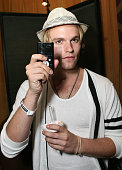 Actor Van Hansis poses in the Daytime Emmy official gift lounge produced by On 3 Productions held at The Orpheum Theatre on August 29 2009 in Los...
