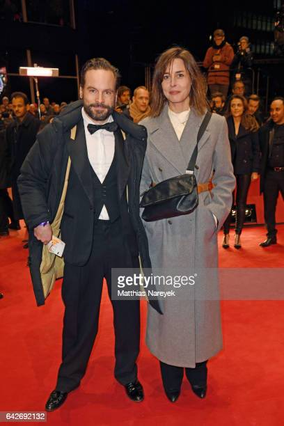 Actor Vanja Mues and a guest arrive for the closing ceremony of the 67th Berlinale International Film Festival Berlin at Berlinale Palace on February...