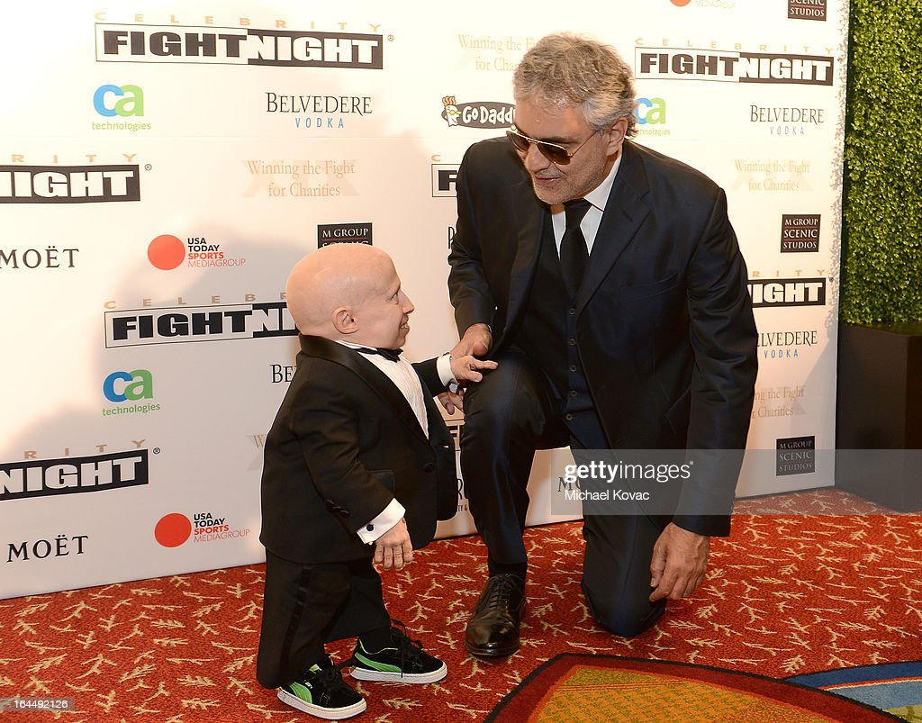 Actor <a gi-track='captionPersonalityLinkClicked' href=/galleries/search?phrase=Verne+Troyer&family=editorial&specificpeople=1521173 ng-click='$event.stopPropagation()'>Verne Troyer</a> and Singer <a gi-track='captionPersonalityLinkClicked' href=/galleries/search?phrase=Andrea+Bocelli&family=editorial&specificpeople=211558 ng-click='$event.stopPropagation()'>Andrea Bocelli</a> with Moet & Chandon at Celebrity Fight Night XIX at JW Marriott Desert Ridge Resort & Spa on March 23, 2013 in Phoenix, Arizona.