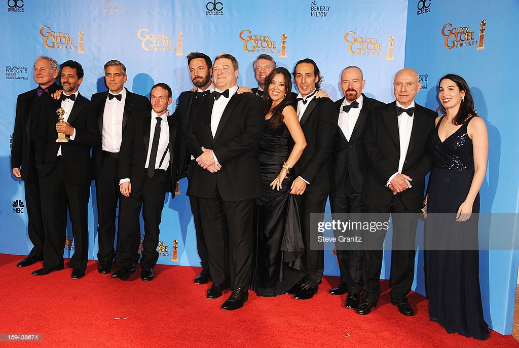 Actor Victor Garber, producer Grant Heslov, actor-producer George Clooney, actor-director Ben Affleck, actors John Goodman and Tate Donovan, producer Chay Carter, composer Alexandre Desplat, actors Bryan Cranston and Alan Arkin, and producer Nina Wolarsky pose in the press room at the 70th Annual Golden Globe Awards held at The Beverly Hilton Hotel on January 13, 2013 in Beverly Hills, California.