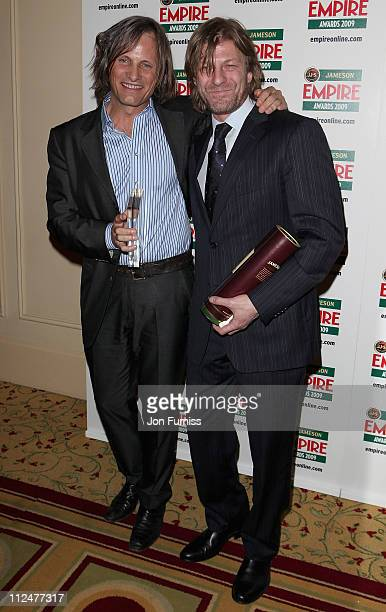 Actor Viggo Mortensen with his Empire Icon award and actor Sean Bean during the Jameson Empire Awards at the Grosvenor House Hotel on March 29 2009...