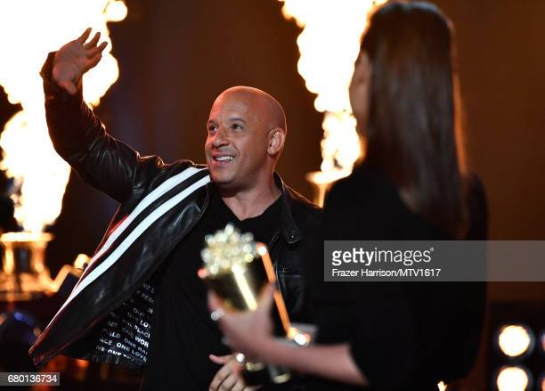 Actor Vin Diesel accepts the Generation award for 'The Fast and the Furious' from actor Gal Gadot onstage during the 2017 MTV Movie And TV Awards at...