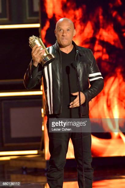Actor Vin Diesel accepts the Generation Award on behalf of the cast and crew of the 'Fast and the Furious' franchise onstage during the 2017 MTV...