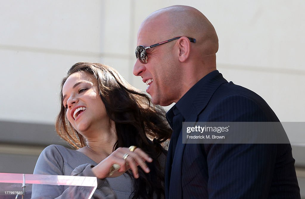 Actor Vin Diesel (R) and actress Michelle Rodriguez during the ceremony honoring Vin Diesel on The Hollywood Walk of Fame on August 26, 2013 in Hollywood, California.