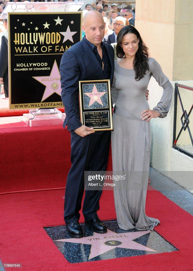Actor Vin Diesel and actress Michelle Rodriguez participates in the Star Ceremony for Vin Diesel on the Hollywood Walk Of Fame held on August 26, 2013 in Hollywood, California.