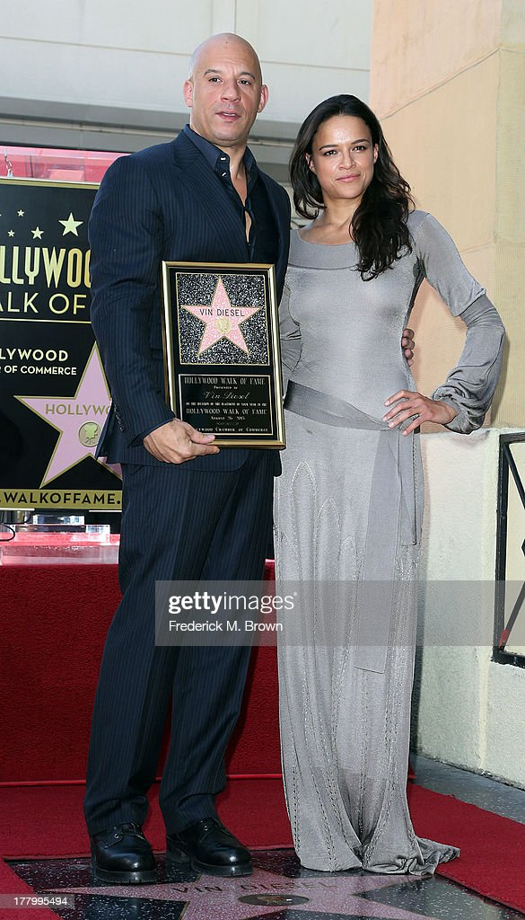 Actor Vin Diesel (L) and actress Michelle Rodriguez pose during ceremony honoring him on The Hollywood Walk of Fame on August 26, 2013 in Hollywood, California.