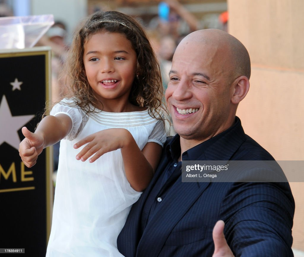 Actor <a gi-track='captionPersonalityLinkClicked' href=/galleries/search?phrase=Vin+Diesel&family=editorial&specificpeople=171983 ng-click='$event.stopPropagation()'>Vin Diesel</a> and daughter Hania Riley participate in the Star Ceremony for <a gi-track='captionPersonalityLinkClicked' href=/galleries/search?phrase=Vin+Diesel&family=editorial&specificpeople=171983 ng-click='$event.stopPropagation()'>Vin Diesel</a> on the Hollywood Walk Of Fame held on August 26, 2013 in Hollywood, California.