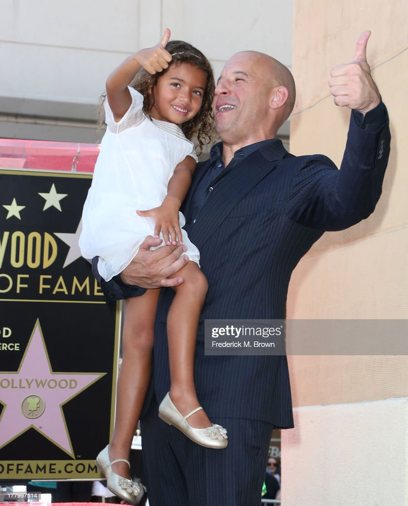 Actor <a gi-track='captionPersonalityLinkClicked' href=/galleries/search?phrase=Vin+Diesel&family=editorial&specificpeople=171983 ng-click='$event.stopPropagation()'>Vin Diesel</a> and his daughter react during ceremony honoring him on The Hollywood Walk of Fame on August 26, 2013 in Hollywood, California.