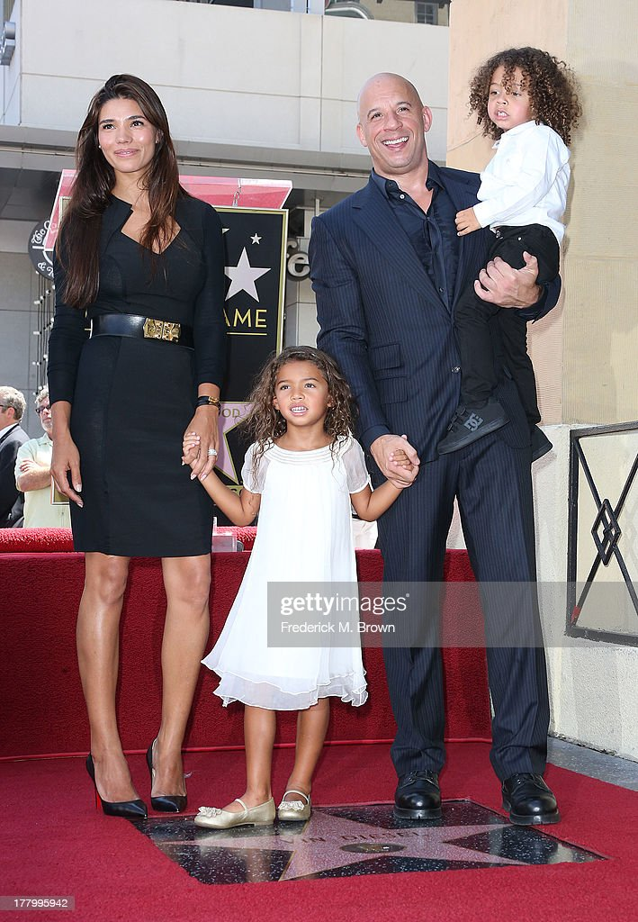 Actor <a gi-track='captionPersonalityLinkClicked' href=/galleries/search?phrase=Vin+Diesel&family=editorial&specificpeople=171983 ng-click='$event.stopPropagation()'>Vin Diesel</a> and his family during the ceremony honoring him on The Hollywood Walk of Fame on August 26, 2013 in Hollywood, California.