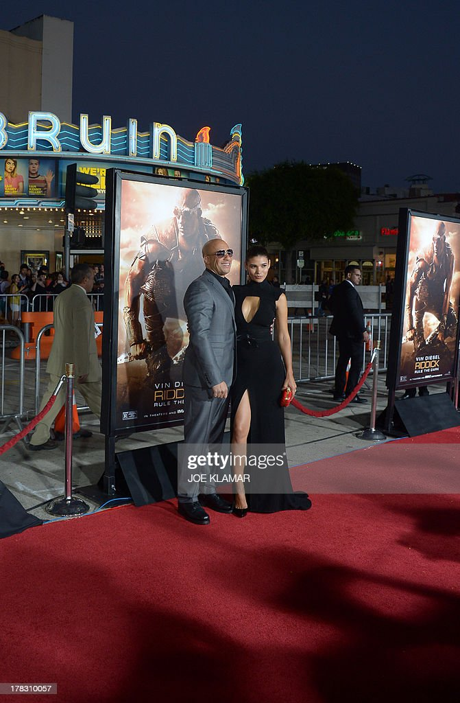 Actor Vin Diesel and model Paloma Jimenez attend the 'Riddick' premiere on August 28, 2013 in Westwood, California.