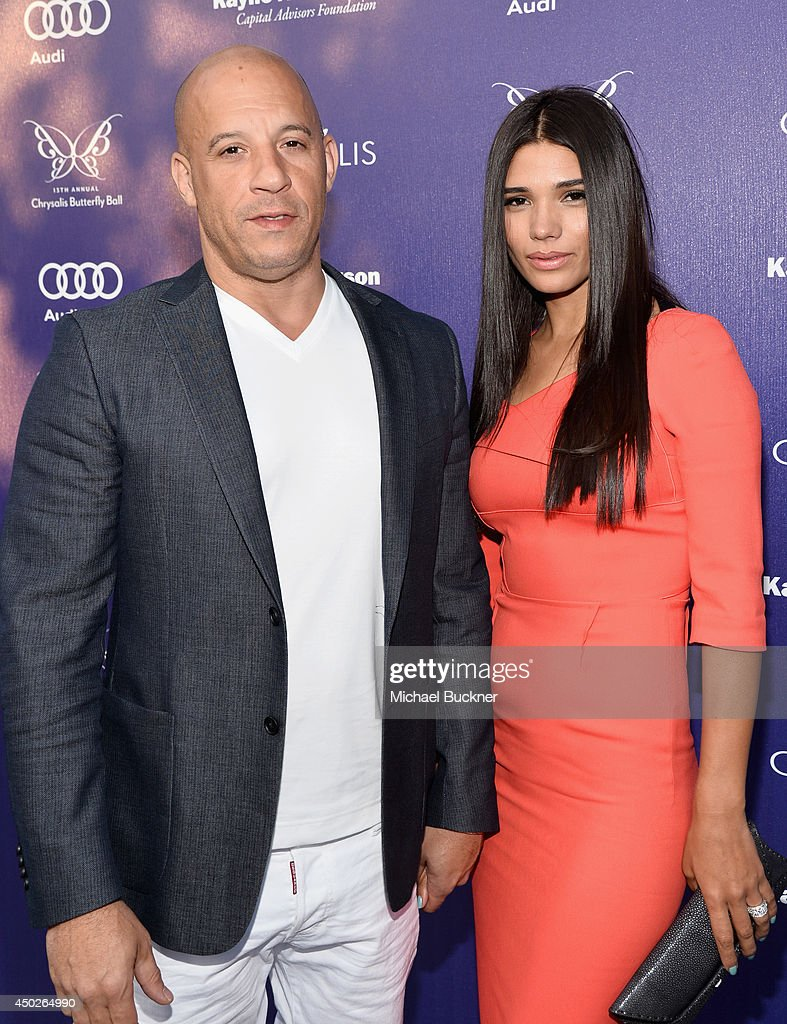 Actor <a gi-track='captionPersonalityLinkClicked' href=/galleries/search?phrase=Vin+Diesel&family=editorial&specificpeople=171983 ng-click='$event.stopPropagation()'>Vin Diesel</a> (L) and Paloma Jimene arrive at the 13th Annual Chrysalis Butterfly Ball in Los Angeles, California on June 7th, 2014.