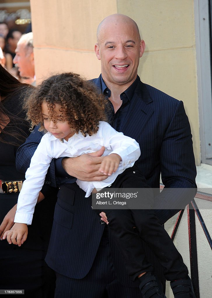 Actor Vin Diesel and son Filmi participate in the Star Ceremony for Vin Diesel on the Hollywood Walk Of Fame held on August 26, 2013 in Hollywood, California.