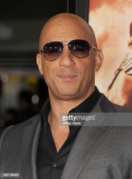 Actor Vin Diesel arrives at the Los Angeles premiere of 'Riddick' at the Westwood Village Theatre on August 28 2013 in Westwood California