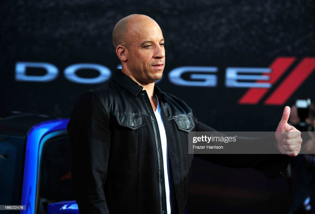 Actor <a gi-track='captionPersonalityLinkClicked' href=/galleries/search?phrase=Vin+Diesel&family=editorial&specificpeople=171983 ng-click='$event.stopPropagation()'>Vin Diesel</a> arrives at the Premiere Of Universal Pictures' 'Fast & Furious 6' on May 21, 2013 in Universal City, California.