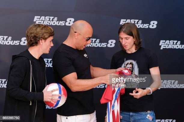 Actor Vin Diesel Atleico de Madrid players Antoine Griezmann and Filipe Luis attend the photocall of FAST amp FURIOUS 8 in Madrid Spain April 6 2017