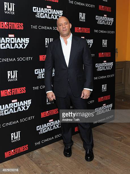 Actor Vin Diesel attends The Cinema Society with Men's Fitness FIJI Water host a screening of 'Guardians of the Galaxy' on July 29 2014 in New York...