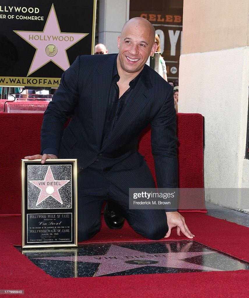 Actor <a gi-track='captionPersonalityLinkClicked' href=/galleries/search?phrase=Vin+Diesel&family=editorial&specificpeople=171983 ng-click='$event.stopPropagation()'>Vin Diesel</a> during the ceremony honoring him on The Hollywood Walk of Fame on August 26, 2013 in Hollywood, California.