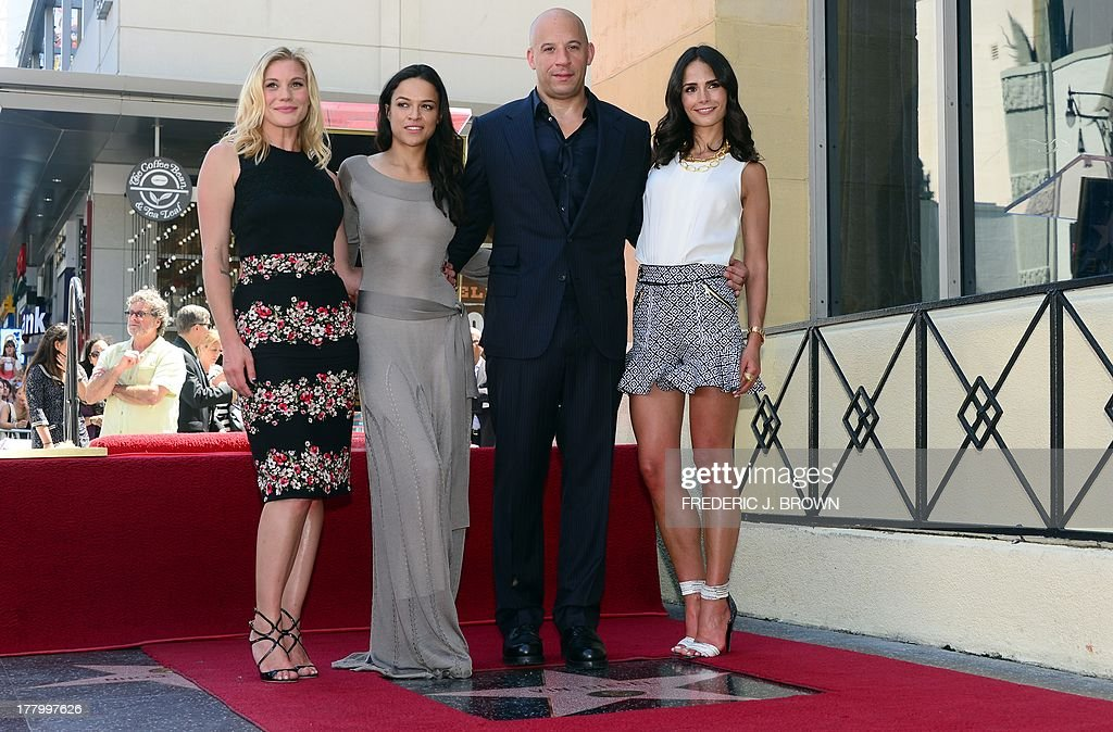Actor Vin Diesel poses during his 'Star' ceremony on the Hollywood Walk of Fame on August 26, 2013 in Hollywood, California with Katee Sackhoff (L); Michelle Rodriguez (2/L) and Jordan Brewster (R). The 46 year old American actor received the 2,504th Star on the Hollywood Walk of Fame in the Category of Motion Pictures. AFP PHOTO/Frederic J. BROWN