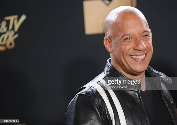 Actor Vin Diesel poses in the press room at the 2017 MTV Movie and TV Awards at The Shrine Auditorium on May 7 2017 in Los Angeles California