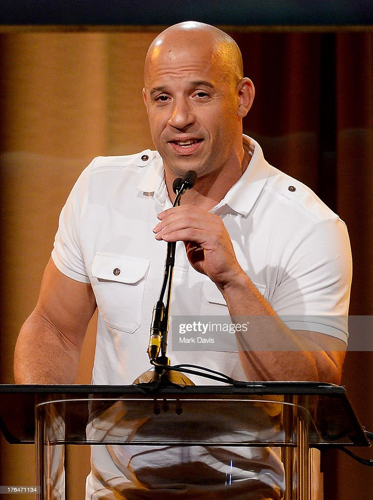 Actor <a gi-track='captionPersonalityLinkClicked' href=/galleries/search?phrase=Vin+Diesel&family=editorial&specificpeople=171983 ng-click='$event.stopPropagation()'>Vin Diesel</a> speaks onstage at the Hollywood Foreign Press Association's 2013 Installation Luncheon at The Beverly Hilton Hotel on August 13, 2013 in Beverly Hills, California.
