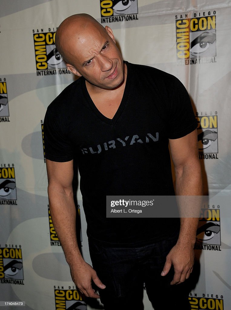 Actor <a gi-track='captionPersonalityLinkClicked' href=/galleries/search?phrase=Vin+Diesel&family=editorial&specificpeople=171983 ng-click='$event.stopPropagation()'>Vin Diesel</a> speaks onstage at the 'Kick-Ass 2' and 'Riddick' Panels during Comic-Con International 2013 at San Diego Convention Center on July 19, 2013 in San Diego, California.