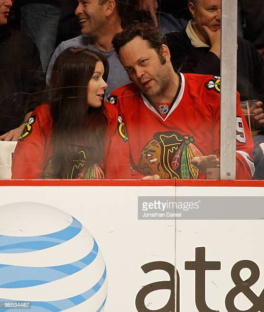 Actor Vince Vaughn and his wife Kyla Weber chat as they watch the Chicago Blackhawks take on the Nashville Predators in Game Two of the Western...