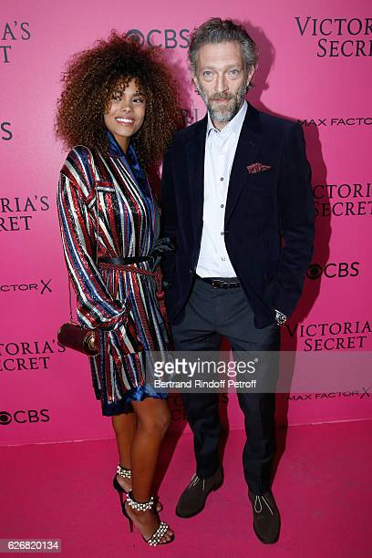Actor Vincent Cassel and his companion Tina Kunakey attend the 2016 Victoria's Secret Fashion Show Held at Grand Palais on November 30 2016 in Paris...