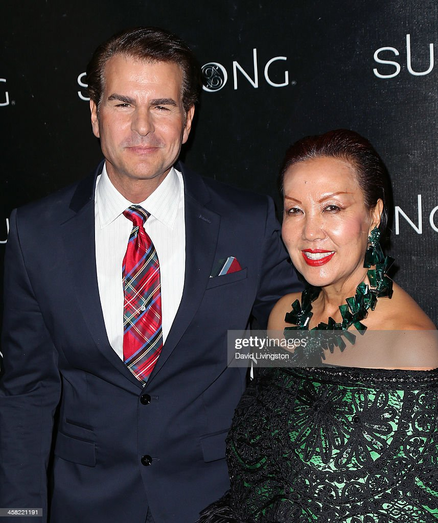 Actor Vincent De Paul (L) and designer Sue Wong attend Sue Wong's holiday party at her home on December 20, 2013 in Los Angeles, California.