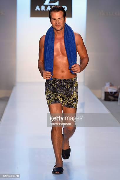Actor Vincent De Paul walks the runway at the AZ Araujo show during MercedesBenz Fashion Week Swim 2015 at The Raleigh on July 21 2014 in Miami Beach...