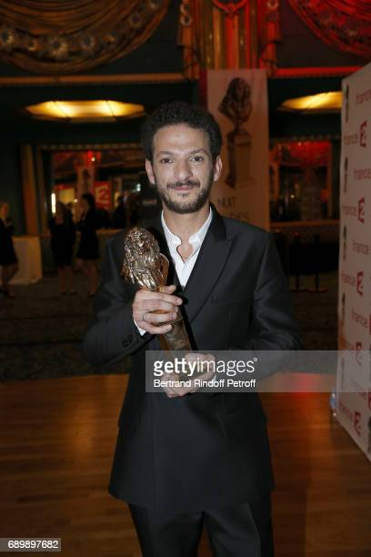 Actor Vincent Dedienne receives a 'Moliere' award during 'La Nuit des Molieres 2017' at Folies Bergeres on May 29 2017 in Paris France
