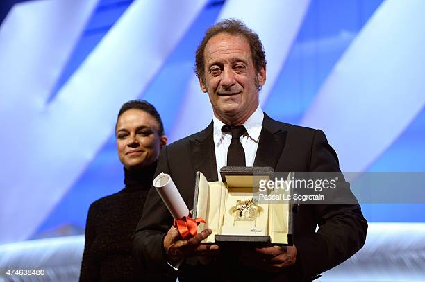 Actor Vincent Lindon with his Best Actor award for 'La Loi du Marche' on stage during the closing ceremony during the 68th annual Cannes Film...