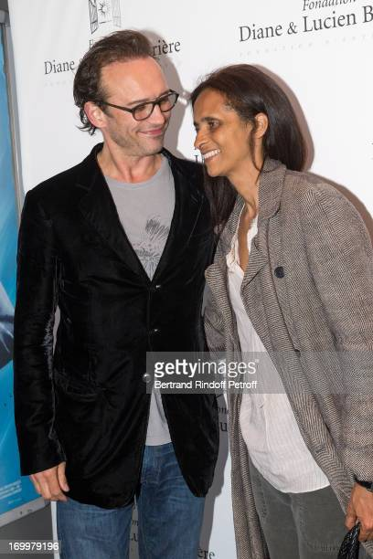 Actor Vincent Perez and his wife actress and director Karine Silla attend the premiere of the film 'Les Petits Princes' at Drugstore Publicis on June...