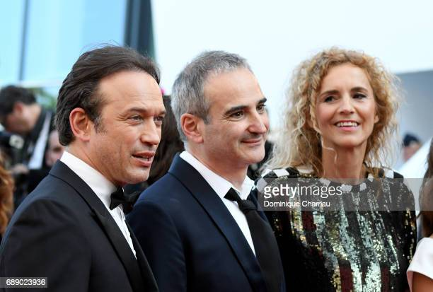 Actor Vincent Perez director Olivier Assayas and novel writer Delphine de Vigan attends the 'Based On A True Story' screening during the 70th annual...