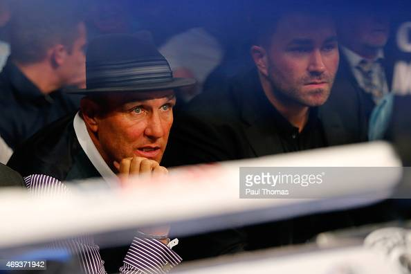 Actor Vinnie Jones and boxing promoter Eddie Hearn watch on during the vacant WBC International Featherweight Championship fight between Josh...