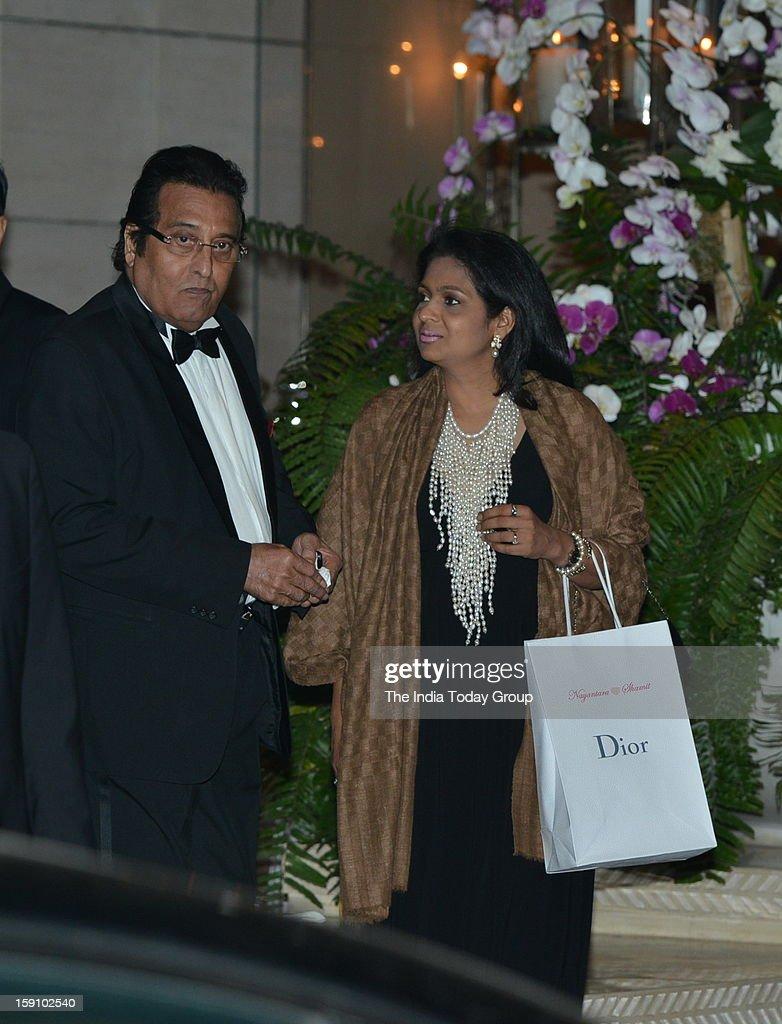 Actor Vinod Khanna with his wife at Mukesh Ambani niece's engagement party at Antilla in Mumbai on Saturday, January 5, 2013.