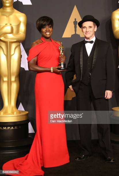 Actor Viola Davis winner of the Best Supporting Actress award for 'Fences' and actor Mark Rylance pose in the press room at the 89th Annual Academy...
