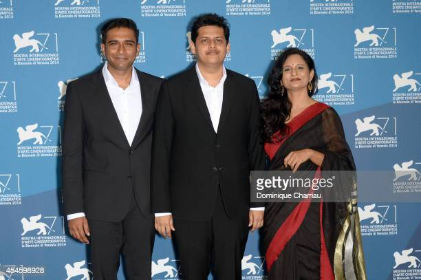 Actor Vivek Gomber director Chaitanya Tamhane and actress Geetanjali Kulkarni attend the 'Court' photocall during the 71st Venice Film Festival at...