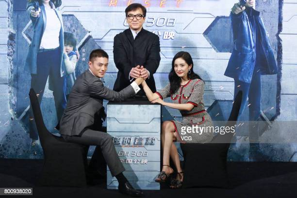 Actor Wallace Huo Chienhwa actor Jackie Chan and actress Yang Mi attend the premiere of South Korean director Chang Yoon Hongseung's film 'Reset' on...