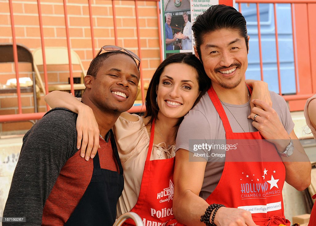 Actor Walter Jones, actress Mirelly Taylor and actor Brian Tee participate in the Hollywood Chamber of Commerce's annual police and firefighters appreciation day at the Hollywood LAPD station on November 28, 2012 in Hollywood, California.