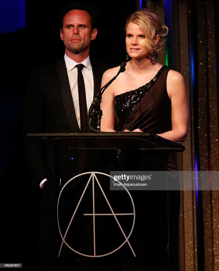 Actor <a gi-track='captionPersonalityLinkClicked' href=/galleries/search?phrase=Walton+Goggins&family=editorial&specificpeople=656067 ng-click='$event.stopPropagation()'>Walton Goggins</a> (L) and actress Joelle Carter speak onstage at the 17th Annual Art Directors Guild Awards, held at The Beverly Hilton Hotel on February 2, 2013 in Beverly Hills, California.