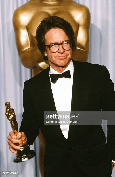 Actor Warren Beatty poses backstage after winning 'Best Director for 'REDS' during the 54th Academy Awards at Dorothy Chandler Pavilion in Los...