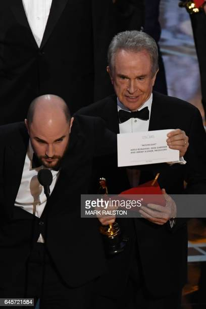 US actor Warren Beatty shows the card reading Best Film 'Moonlight' after mistakingly reading 'La La Land' initially at the 89th Oscars on February...