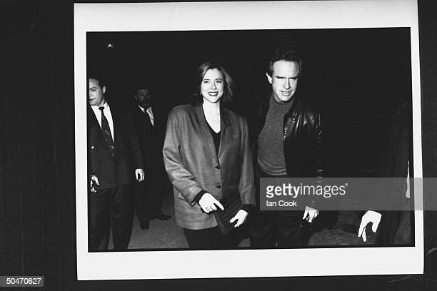 Actor Warren Beatty w girlfriend actress Annette Bening arriving w bodyguards for a QA session w students at Oxford University during promotional...