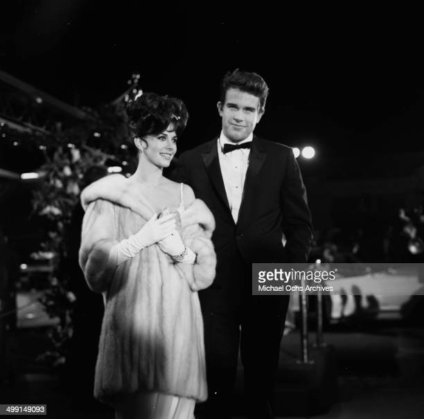 Actor Warren Beatty with actress Natalie Wood attend a party in Los Angeles California