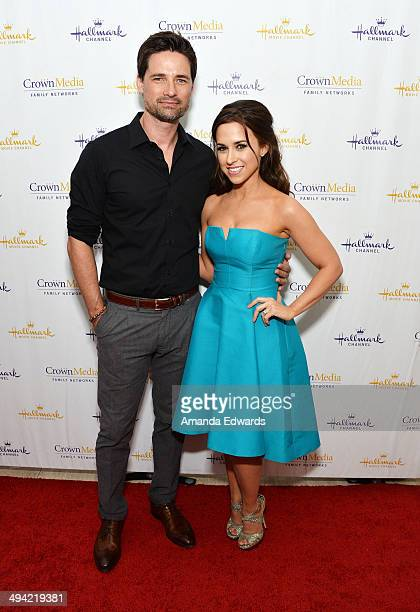 Actor Warren Christie and actress Lacey Chabert arrive at 'The Color Of Rain' premiere screening presented by the Hallmark Movie Channel at The Paley...
