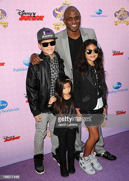 Actor Wayne Brady and children attend the premiere of 'Sofia The First Once Upon a Princess' at Walt Disney Studios on November 10 2012 in Burbank...